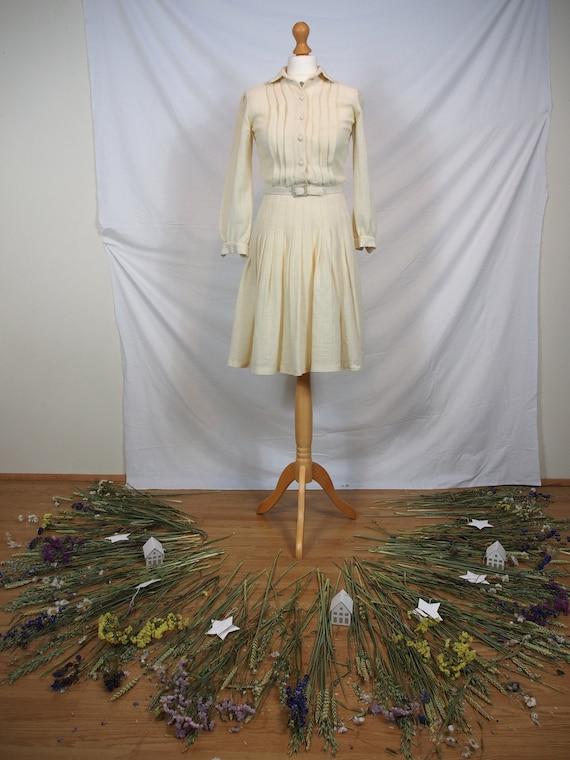 Lovely 1950s cream shirt dress with pleated skirt