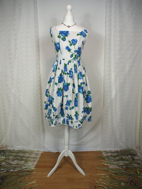 Stunning 1950s blue floral tulip dress