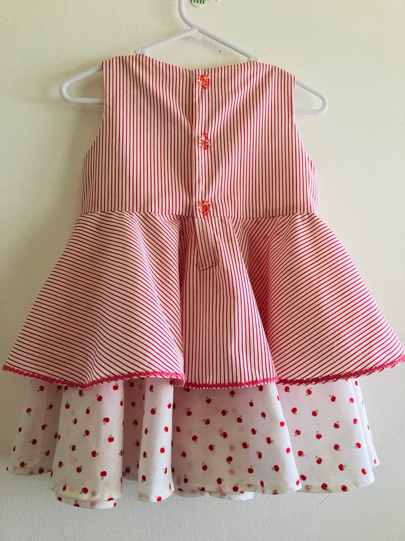 Dress for a 3 year old with a full circle double skirt.