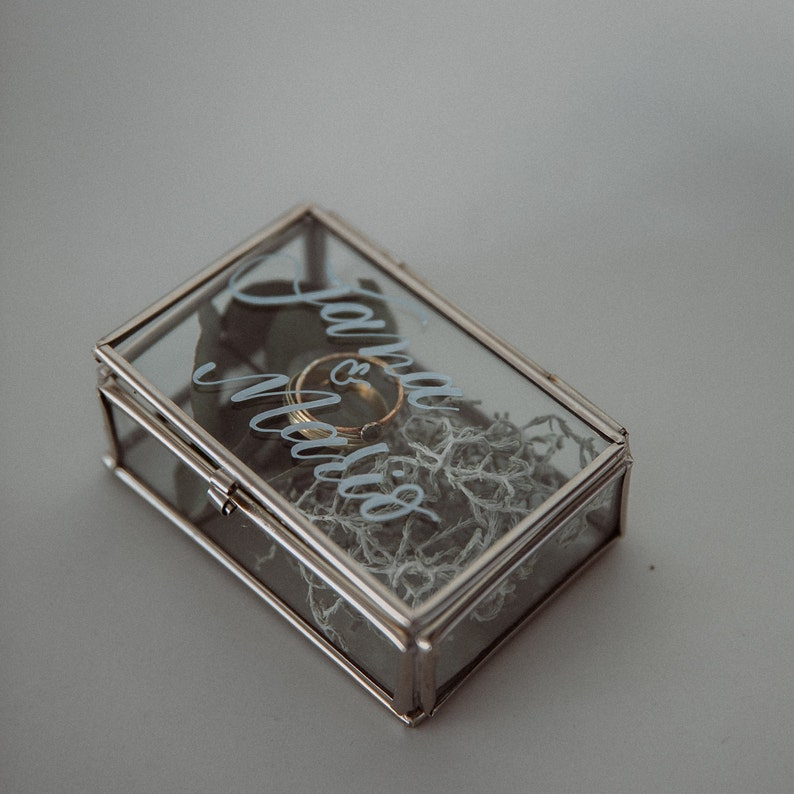 Glass ring box labeled in silver-individually
