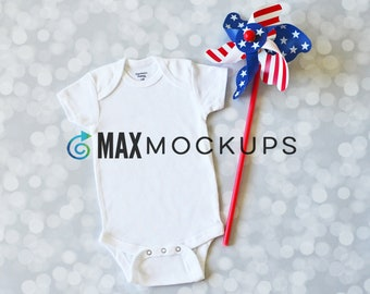 Baby bodysuit MOCKUP, July 4th, flatlay, infant blank display, red white and blue windmill, styled stock photography, download