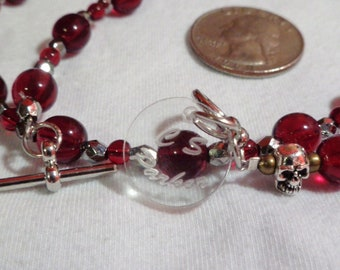 Beautiful 8 and 4mm Czech Glass garnet beads with 4mm faceted chrome spacers. This piece comes with a toggle type closure.