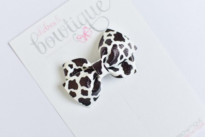 Girls cow hair bow Cow bow Cow print hair bow Cow hair bow Animal print bow Animal print hair bows Baby headband Baby cow bow.