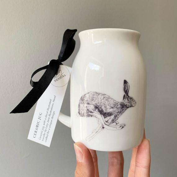Running Hare illustrated ceramic jug / bud vase
