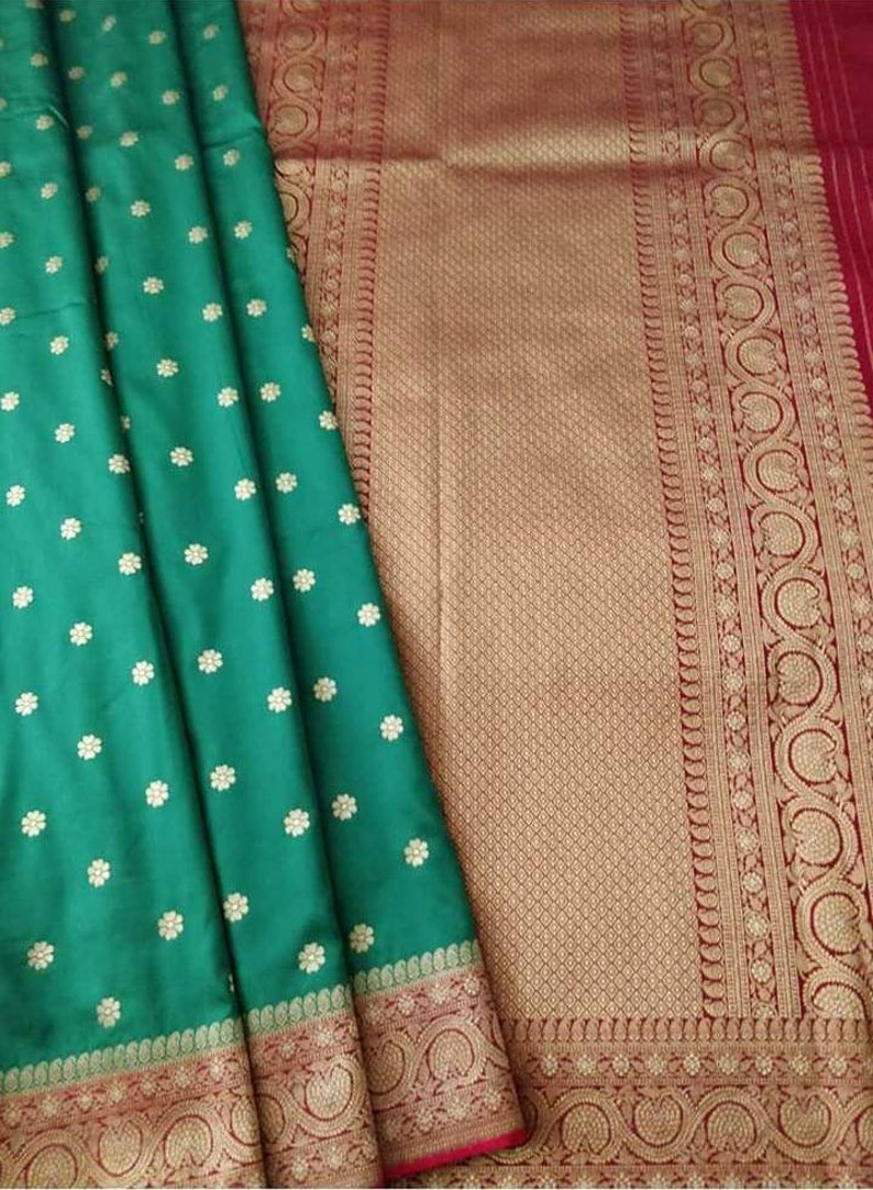 hand brush dyed exclusive designer saree; Dyeable to any shade Zynah Pure Georgette woven Banarasi saree