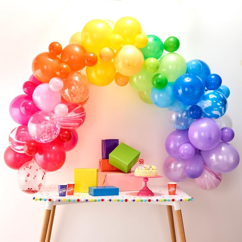 Rainbow Balloon Arch Kit. A fun backdrop for a kids birthday party. (ohpartydays)