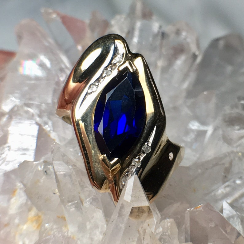Stamped 10k XPS 2g Size 5 34 ? Beautiful Deep Blue Stone Vintage Lab Sapphire and Diamond Accents Yellow Gold Ring