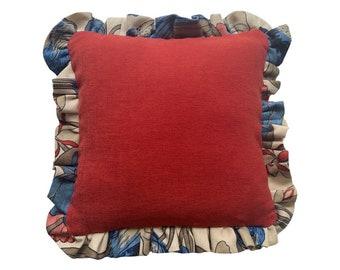 Decorative ruffle edge cushion.