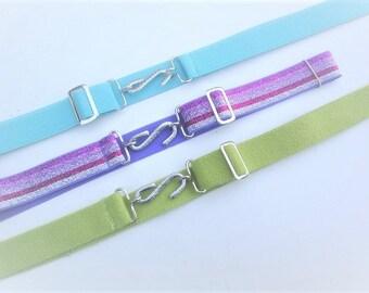 velcro fastening  black polyproplene  belts fully adjustable  slider bar to fit 30 to 44 inch waist