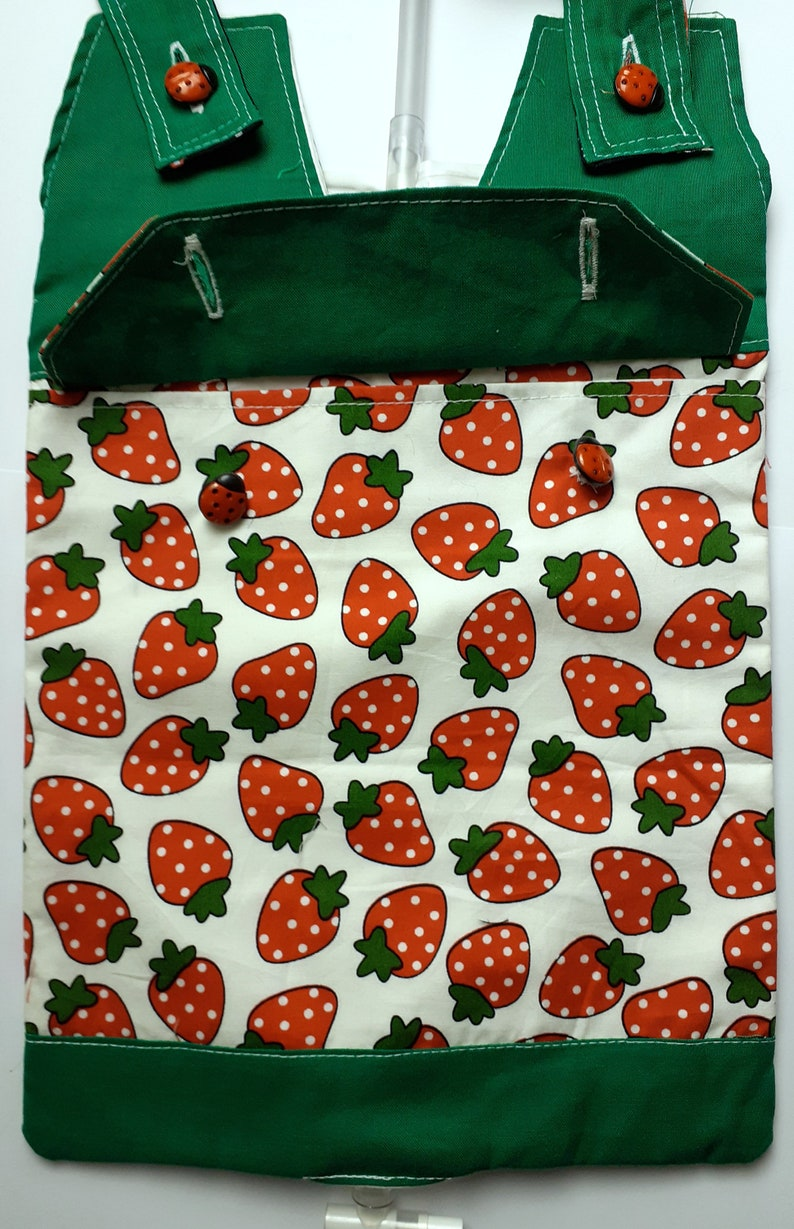 Strawberries Catheter night bag cover with a pocket and handle .