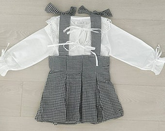 1cdb4e587c97 Bow broderie blouse and gingham dungaree style skirt. 3 years