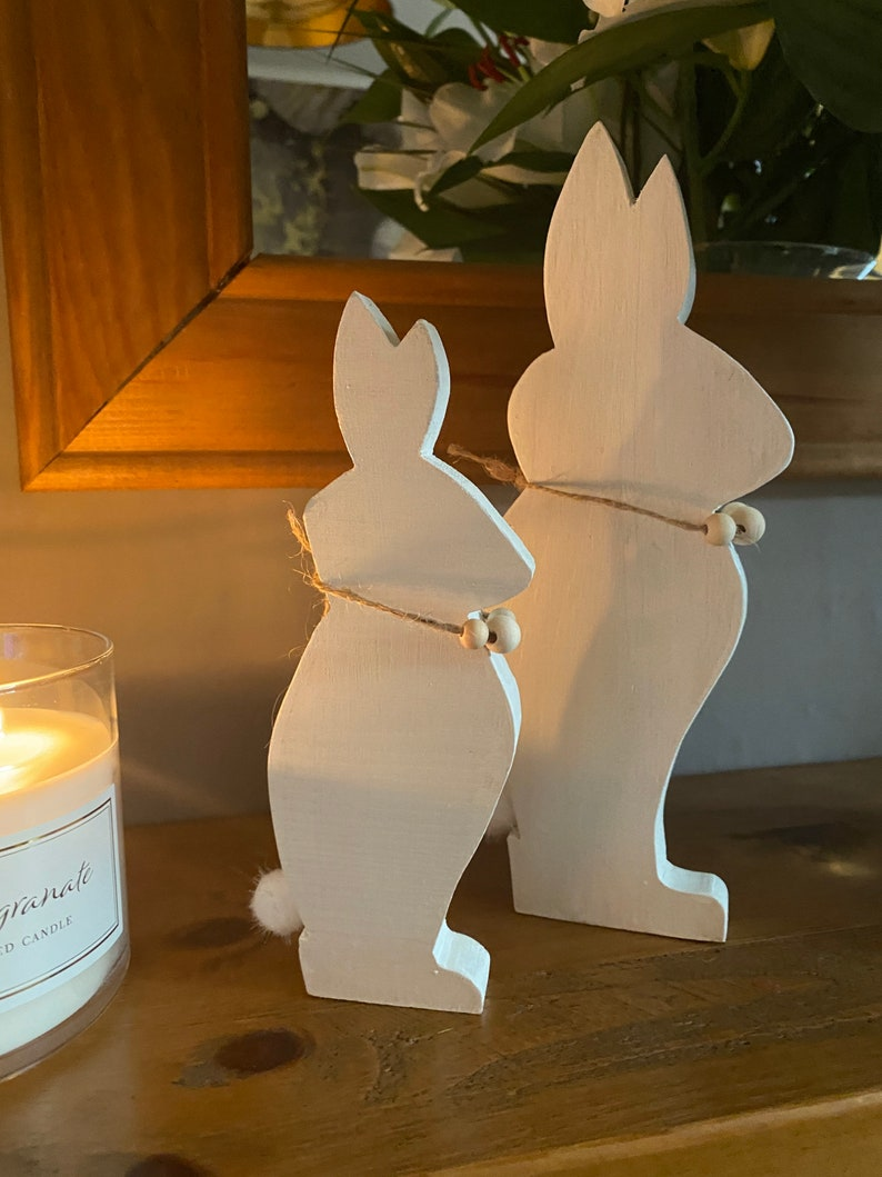 Two Bunnies Handcrafted From Hardwood Available In Several Colours.