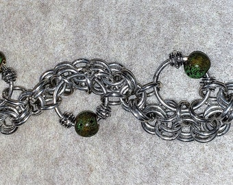 Sterling Silver Big O With Double Link Trailing Chain and Ceramic Accent Stones Bracelet