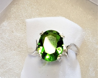 Sterling Silver With Faceted Oval Peridot Gemstone Ring
