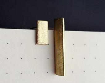Mismatched gold line studs.