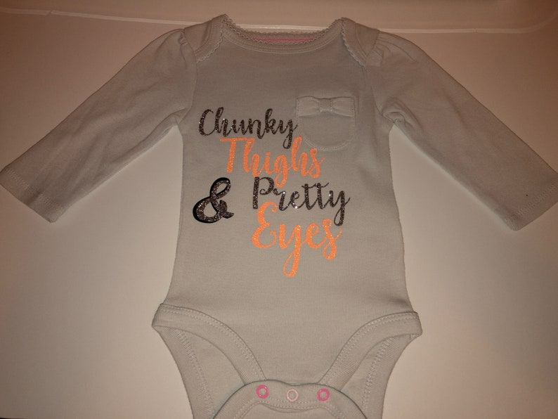 Chunky thighs and pretty eyes onsie