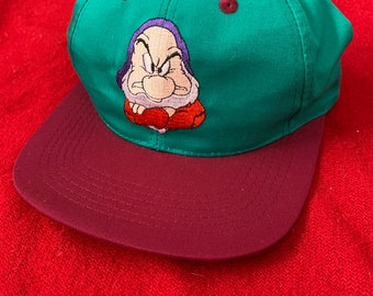 3bcdf5d1bae Vintage 1994 Snow White and the Seven Dwarfs Promo Hat Embroidered Grumpy  Cap Red Turquoise Youth Snapback Walt Disney Masterpieces 1990s