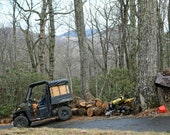 EDITORIAL USE ONLY Polaris Ranger on hill with Champion Log Splitter, Cloudy Day in the Mountains making firewood for wood stove heater.