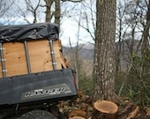 EDITORIAL USE ONLY Polaris Ranger on hill, Cloudy Day in the Mountains making firewood from logs for wood stove heat. Plenty of