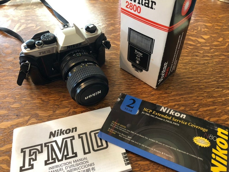Nikon FM10 35mm camera with 35-70mm lens and Vivitar 2800 Auto Flash -  excellent condition