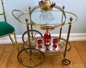 Neoclassical oval solid brass serving trolley from France with removable serving tray antique style with embellishments. Très Chic!