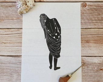 Ruth-  Original linocut print of a woman in a polka-dot swimming costume and towel, inspired by wild swimming