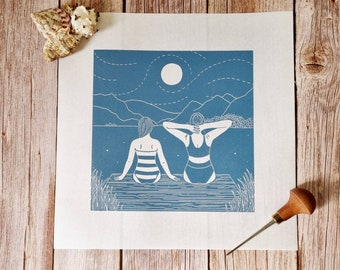 Kindred Spirits - Original linocut print of two women sat at the side of a lake gazing at the water