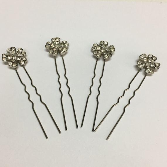 Vintage rhinestone hairpins, unused.
