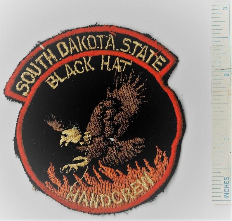 Hand Crew Shoulder Patch Us Quilt Vintage c1970s SOUTH DAKOTA State Black Hat
