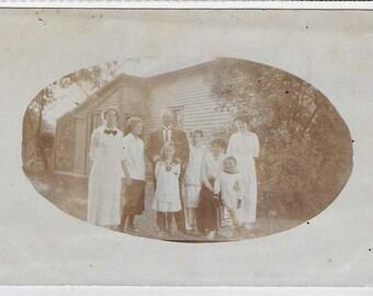 Faded American Unused Vintage Postcard of a Family Portrait