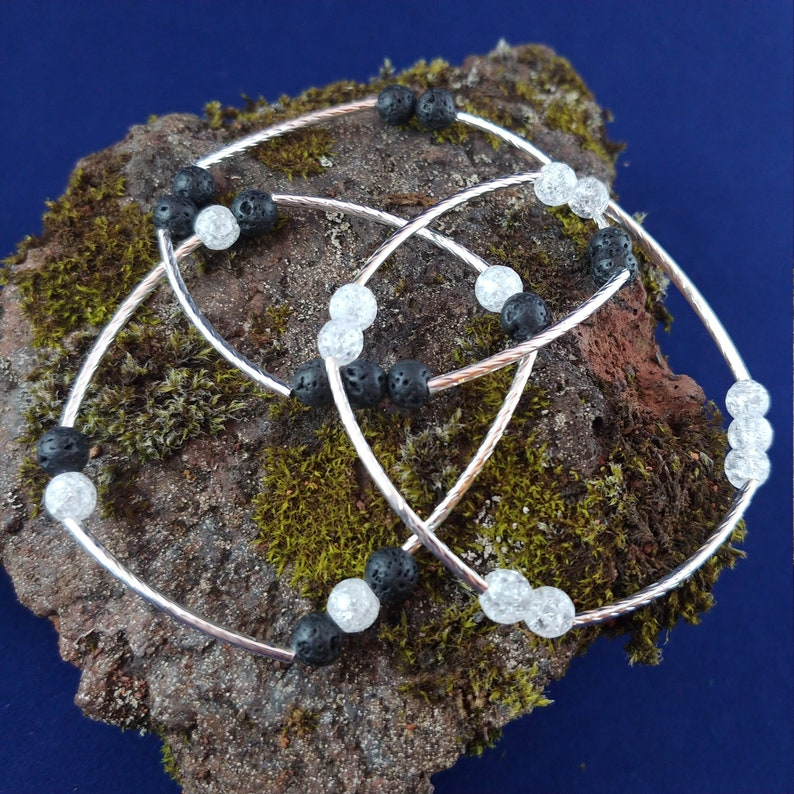 Three Lava and Crackle Crystal Quartz Bracelets Together as a image 0