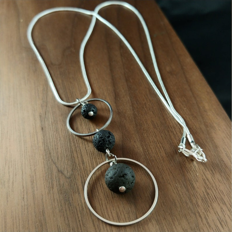 Circle Necklace with Two Rings and Three Sizes of Lava image 0