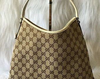 822703a45503 Gucci Britt GG Canvas Hobo Bag- Beige and White