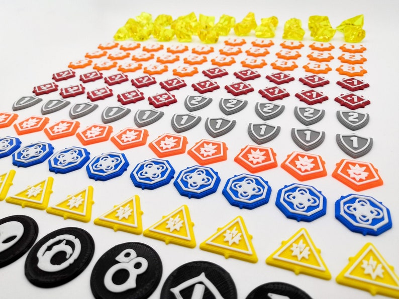 Keyforge: Set 129x tokens also compatible with Worlds in image 1
