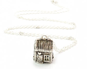 The Gardeners Cottage Silver Bell Pendant. A little silver thatched cottage with lots of tiny details that gently tinkles as you move.