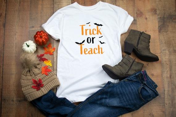 Trick or Teach Halloween tshirt, womens tshirt, teacher shirt for halloween, Halloween tee, Trick or treat, Halloween shirt for teachers