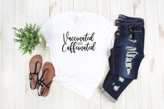 Popular tshirt vaccinated and caffeinated funny tshirts for women current trendy unisex vneck tees Bella Canvas 3005