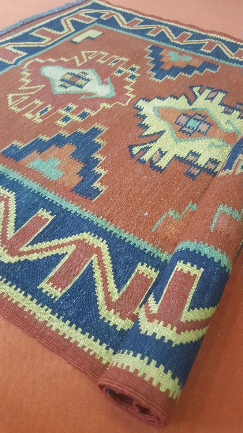 vintage turkish kilim  size is in feet 4.8 x 3.2