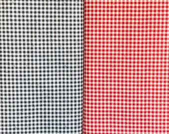 Buon Appetito by Me-O-My, SPX Fabrics, in black and red colourways. Gingham-like check with speckles of colour all-over