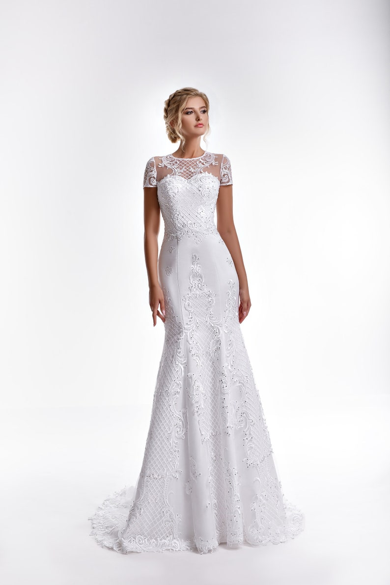 Beautiful Crystal Beaded Lace On Tulle Over Satin Fit And Flare Mermaid Wedding Dress With Illusion Neckline Cap Sleeves And Corset Close