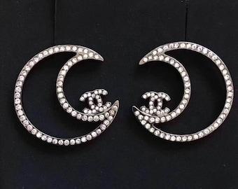 b6cb529cae Orecchini Chanel cristalli oro bianco placcato tono