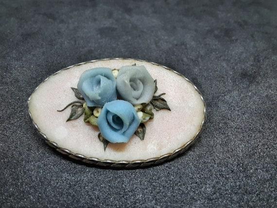 Vintage carved brooch made of blue roses stone