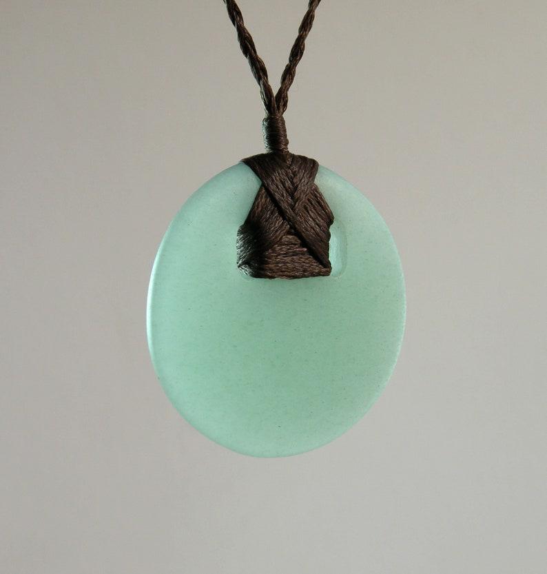 Hand-carved round aventurine pendant