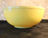 Vintage, Primary colors, Pyrex, yellow nesting bowl. 1st edition line, Not numbered.