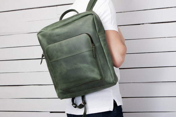 Minimalist green leather backpack with zipper
