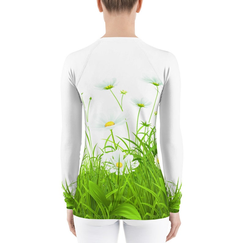 bright sports shirt with flowers print comfortable sirt for walks. protective skin with long sleeves White Rash Guard with camomiles