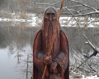 Wooden figure of scandinavian god Odin.