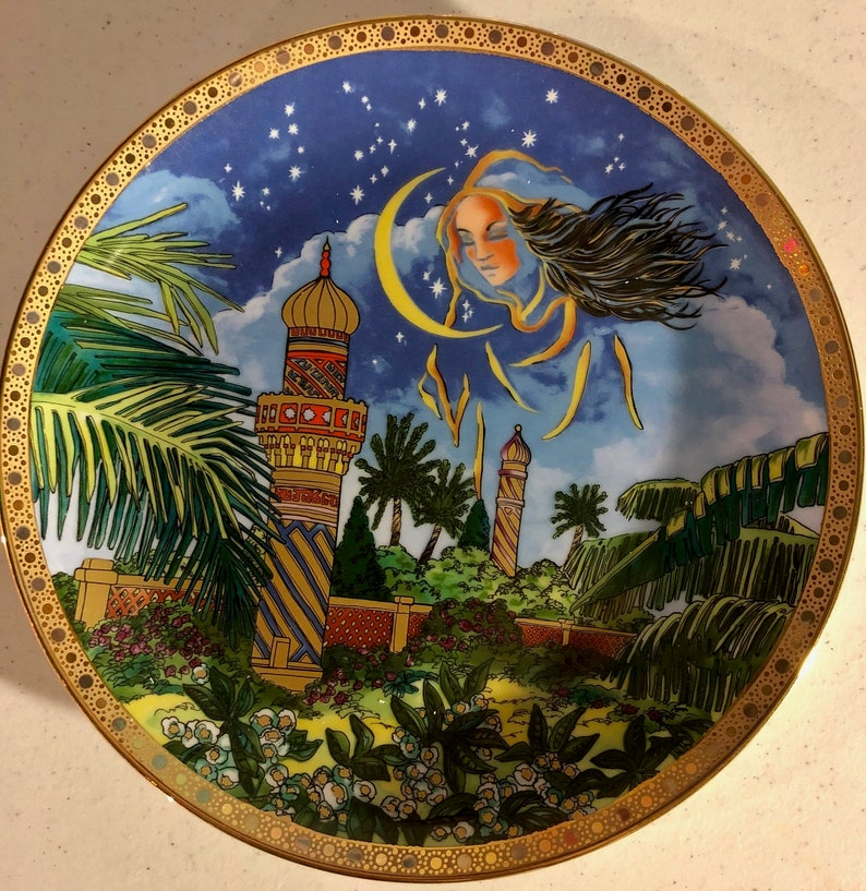Porcelaine Ariel by Mossan Eskandar~ Beautiful Collector plate with accented Gold and Platinum Border.