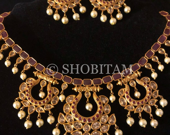 Pretty Necklace Set with faux stones and hanging pearls.