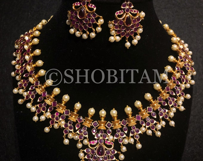 Studded necklace and Earrings set with faux rubbies in matt finish base | Shobitam Jewelry